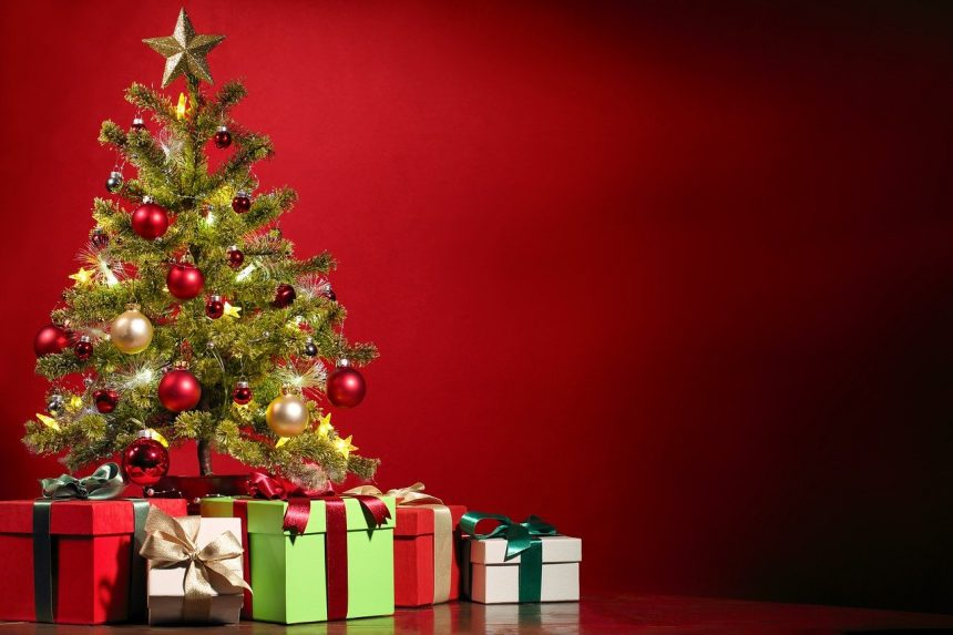 What is typically done in town in the way of gift giving and tipping during Christmas season?